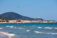 Beautiful beach with kitesurfer in Sardinia Stock Image