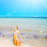 A beautiful beach with a kneeling girl Royalty Free Stock Image