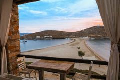 Beautiful beach of Kolona double bay Kythnos island, Cyclades, Greece at the end of the day view from the Kolona. Restaurant. Travel destinations September 2018 royalty free stock photography