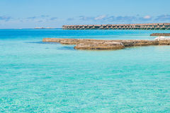 Beautiful beach landscape at Maldives. Beautiful paradise beach turquoise transparent sea around the island. Summer vacation on Maldives Stock Photos