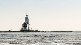 A beautiful beach and lighthouse at sunrise (Marken The Netherla Royalty Free Stock Images