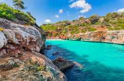 Beautiful beach Majorca Cala des Moro, Spain Mediterranean Sea. Beautiful beach of Cala des Moro, idyllic bay with turquoise sea water on Mallorca island, Spain Royalty Free Stock Image