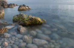 Beautiful beach with mossy rocks Stock Images