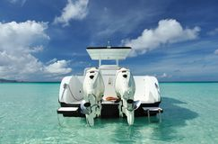 Beautiful beach with motor boat Stock Images