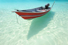 Beautiful beach with motor boat Royalty Free Stock Photo