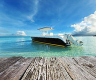 Beautiful beach with motor boat Stock Photography