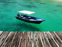 Beautiful beach with motor boat Royalty Free Stock Image