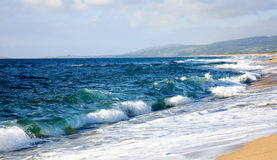 Beautiful beach with nice waves Sardinia Italy Stock Photography