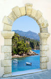 Beautiful beach through the old castle Stock Image