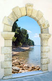 Beautiful beach through the old castle Royalty Free Stock Photo
