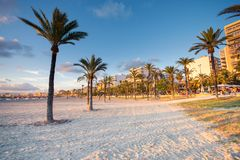 Sunset in Las Maravillas coast in Palma de Mallorca. Beautiful beach with palm trees and white sand in famous Palma de Mallorca stock photography