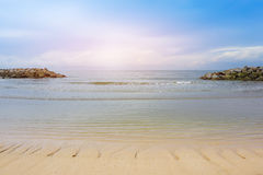 Beautiful  beach with rock dam and bright cloudy sky Stock Images