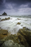 Beautiful beach with rock hitting by waves. soft focus due to long exposure Stock Photography