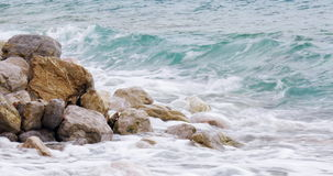 Beautiful beach rocks on the beach with splashing sea waves – summer tranquil destination travel 4k video background stock video footage