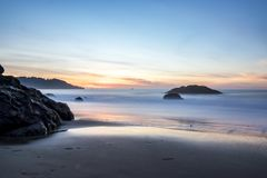 Beautiful Beach with rocks. Long exposure of the sunset on Marshall Beach in San Francisco Stock Images
