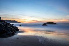 Beautiful Beach with rocks. Long exposure of the sunset on Marshall Beach in San Francisco Royalty Free Stock Images