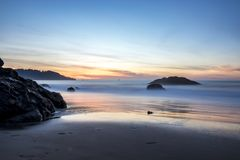 Beautiful Beach with rocks. Long exposure of the sunset on Marshall Beach in San Francisco Stock Photography