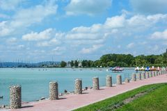 Beautiful beach with sailing boats and paddle boats at the Lake Balaton royalty free stock photography
