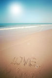 Beautiful beach with sand, blue waves and sky Royalty Free Stock Photos