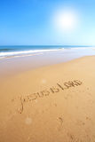 Beautiful beach with sand, blue waves and sky Stock Photography