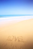Beautiful beach with sand, blue waves and sky Royalty Free Stock Images