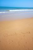 Beautiful beach with sand, blue waves and sky Royalty Free Stock Image