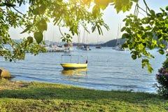 Beautiful beach scene and fishing boat Stock Photo
