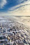 Beautiful beach scene full of pebbles in the coastline Stock Image