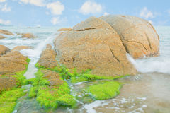 Beautiful beach scene  with the rocks background. Stock Photos