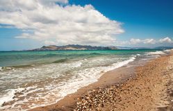 Beautiful beach scenery with an island in the distance Stock Photography