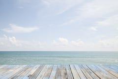 Beautiful beach sea and sky and tropical sea. Wood floor on beautiful beach sea and sky and tropical sea Stock Photo