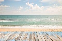 Beautiful beach sea and sky and tropical sea. Wood floor on beautiful beach sea and sky and tropical sea Royalty Free Stock Photography