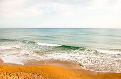 Beautiful beach on the sea with waves on a spring day. Great beach on the Mediterranean Sea in the city of Side Turkey. Tender sea and warm sea with mesmerizing stock photography