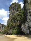 Beautiful beach, sheer cliffs, trees on the rock. TRavel destination - Railay beach, Krabi, Thailand stock photos
