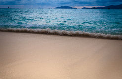 Beautiful beach with small wave at tropical island Stock Photos