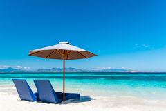 Beautiful beach. Sunbeds with umbrella on the sandy beach near the sea. Summer holiday and vacation concept. Inspirational tropical beach Royalty Free Stock Photos