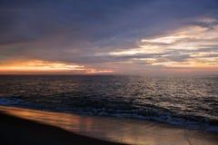 Beautiful Beach Sunrise With Golden Skies Stock Photo