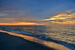 Beautiful Beach Sunrise With Golden Skies Royalty Free Stock Images