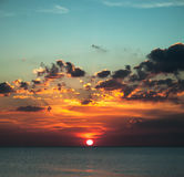 Beautiful beach sunrise over the sea or ocean with clouds Royalty Free Stock Image