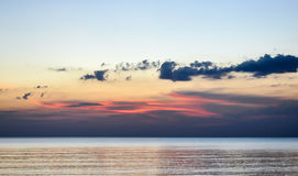 Beautiful beach sunrise over the sea or ocean with clouds Royalty Free Stock Photography