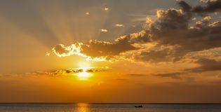 Beautiful beach sunrise over the sea or ocean with clouds Stock Photo