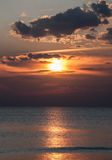Beautiful beach sunrise over the sea or ocean with clouds Royalty Free Stock Photos