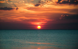 Beautiful beach sunrise over the sea or ocean with clouds Royalty Free Stock Images