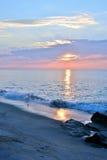 Beautiful Beach Sunrise on a Summer Morning at Rock Jetty Stock Photo