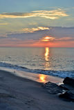 Beautiful Beach Sunrise on a Summer Morning at Rock Jetty Royalty Free Stock Image