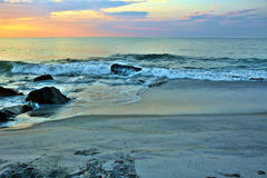 Beautiful Beach Sunrise on a Summer Morning at Rock Jetty Royalty Free Stock Images