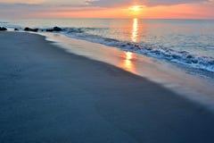 Beautiful Beach Sunrise on a Summer Morning at Rock Jetty Stock Photography