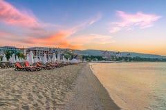 A beautiful beach at sunrise in Sunny Beach on the Black Sea coast of Bulgaria. Chair lounge bulgarian clouds coastline dawn day horizontal morning no people stock image