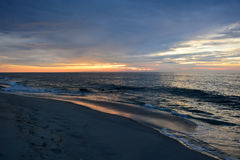 Beautiful Beach Sunrise. The sunrises over the ocean on a summer morning at the beach Stock Photography