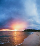 Beautiful beach with sunset Stock Images